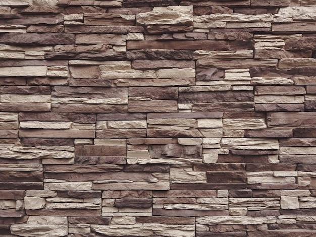 Темно-бежевый и коричневый сланец каменная стена текстура фон