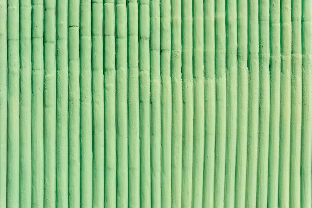 緑のコンクリートの壁からの抽象的な背景。ヴィンテージとレトロな背景。