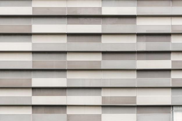 モダンな建物にグレーのブロックが飾られています。抽象的なテクスチャ背景。