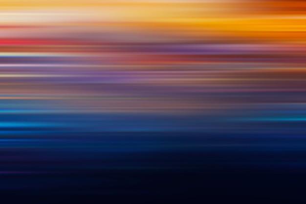 抽象的な技術の背景。市内のカラフルな夜景の動きの効果。