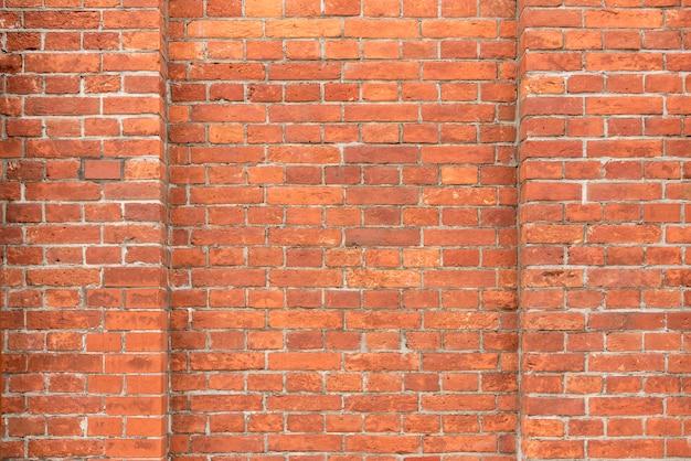 茶色のレンガの壁、ヴィンテージとレトロな背景からの抽象的な背景。