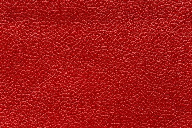赤い牛革、抽象的な背景の質感。