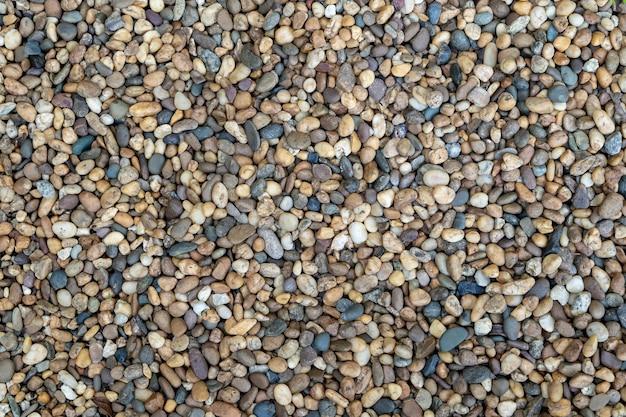 地面に小石のパターンから抽象的な背景