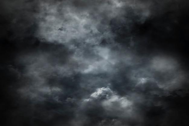 暗い背景に煙からの抽象的な背景