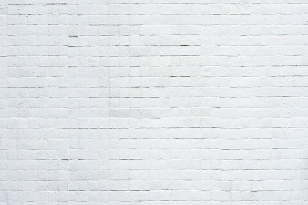 壁に白いレンガパターンから抽象的な背景。ビンテージ背景。