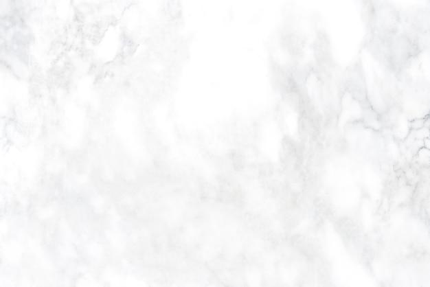 白い大理石のテクスチャから傷がついた抽象的な背景。モダンで豪華な壁。