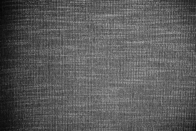 Абстрактная предпосылка от черной текстуры ткани. картинка для добавления текстового сообщения.