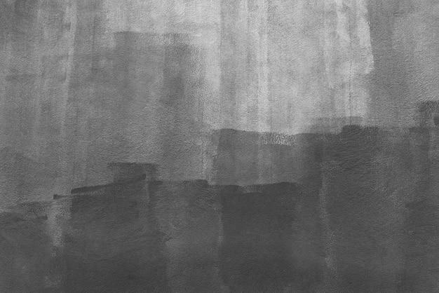 白い壁に描かれた黒い色からの抽象的な背景。アートの背景