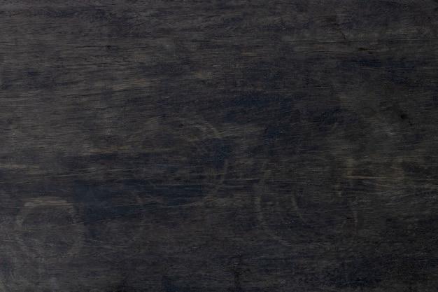 コーヒーの床のガラスの汚れと暗い木製の背景
