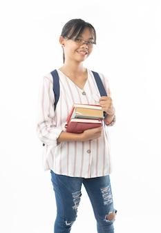 Молодая азиатская студентка с школьной сумкой