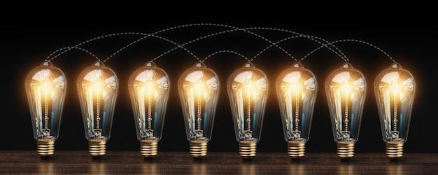 暗い背景に相互接続された多くの電球