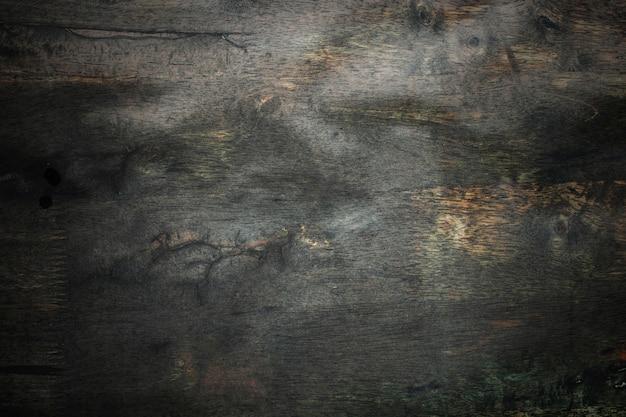 Темный фон из дерева и гранж-текстуры