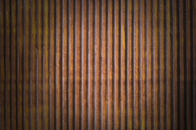 茶色のグランジ亜鉛テクスチャ壁の背景
