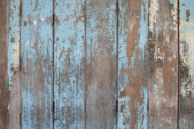 素朴な古い青い木製の背景