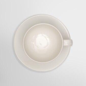 Вид сверху-закрыть белый чашка на белом фоне