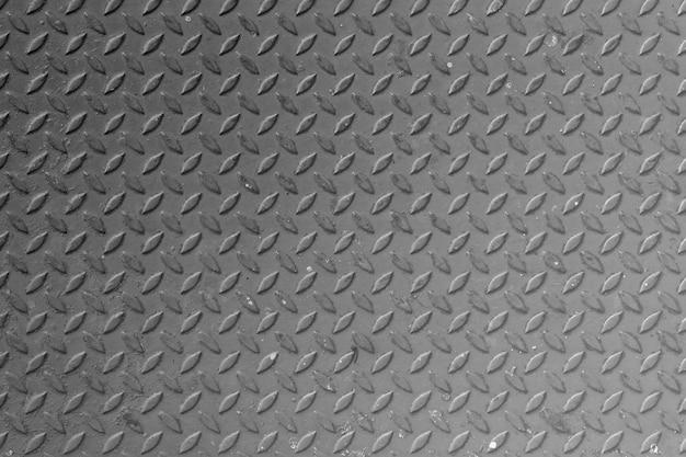 錆びたダイヤモンドの金属プレートのテクスチャのパターンの背景