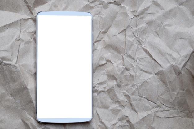 割れた背景にスマートフォン白い空白の画面