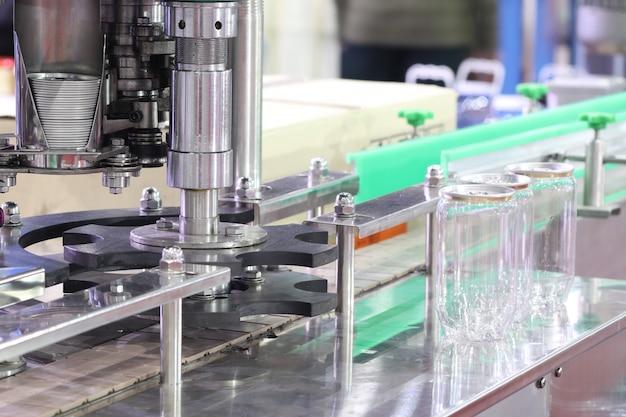 プラスチック缶用アルミ蓋包装機