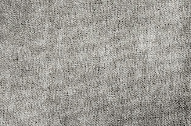 ビンテージの淡いブラックジーンズテクスチャ背景
