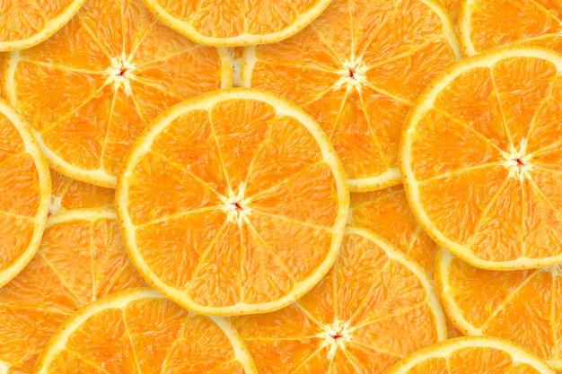 スライスされたオレンジ色の果物の背景自然有機抽出物の山