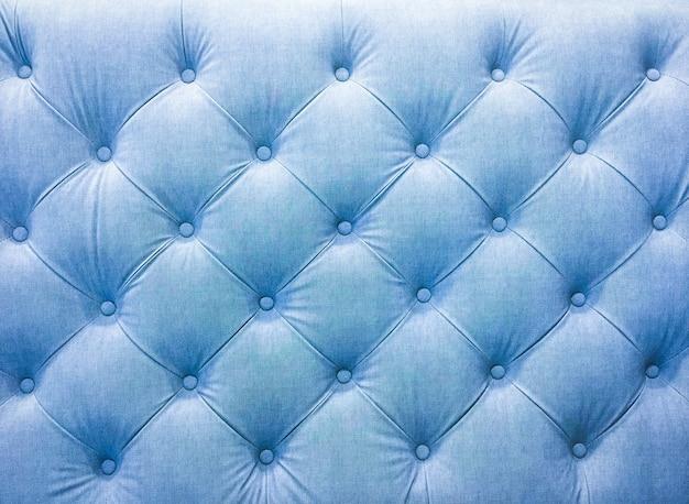 リベット付きの室内装飾ソファ生地。ブルートーン。
