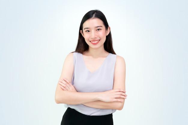 美しいアジアの若い女の子、肖像画が隔離され、タイのビジネス女