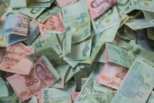 募金箱にタイバーツ紙幣の背景