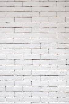 Белая кирпичная стена текстуры картины. сырой винтаж чистый стиль фона.