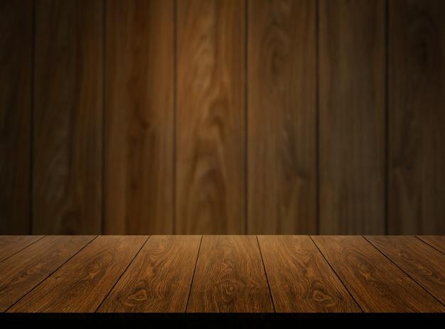木製の壁の前に木製のテーブルは、背景をぼかし。