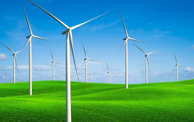 緑の芝生の丘に風力タービンのファーム。