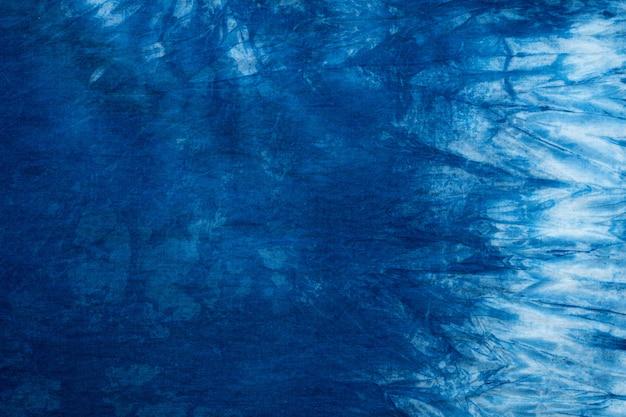 シームレスな染料布の背景、濃い青藍抽象のパターン