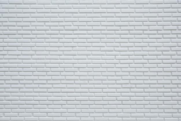背景と織り目加工、白い壁の背景のための白いレンガの壁のパターン