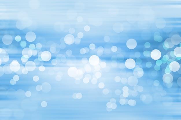 青い背景にはぼやけたライト、青い背景にはライトが付きます。