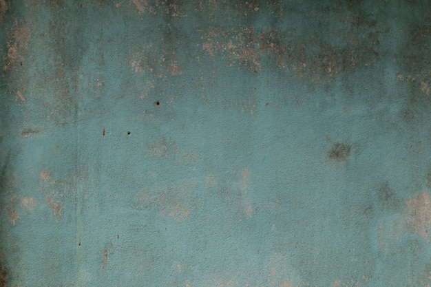 古いセメントの壁のペイント青色の抽象的な背景。