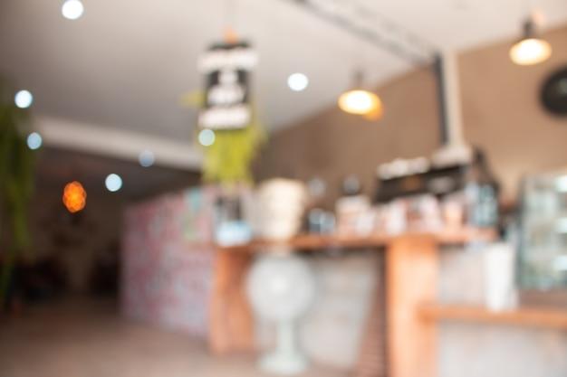ボケ味を持つコーヒーショップで背景をぼかした写真