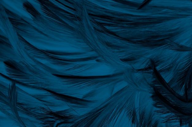 美しい濃い緑色のターコイズブルーのビンテージカラートレンドフェザーテクスチャ背景