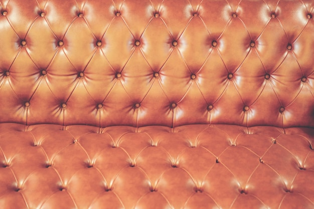 高級革のソファの抽象的なテクスチャ背景