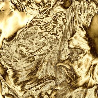 光沢のある金の金属液体テクスチャ背景