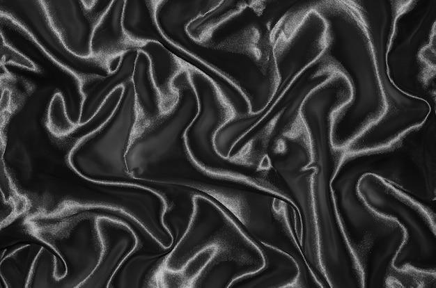 黒い生地とストライプテキスタイルによる背景と壁紙