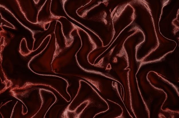 深い赤い生地とストライプテキスタイルによる背景と壁紙