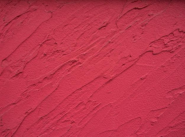 赤い色のセメント壁の背景のテクスチャ