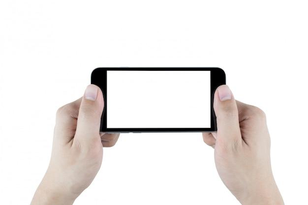 両手は白い背景に分離された黒のスマートフォンを保持しています。