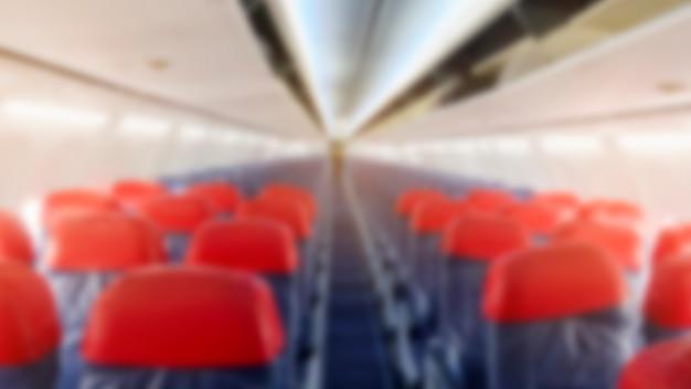 機内の飛行機の座席のぼやけ