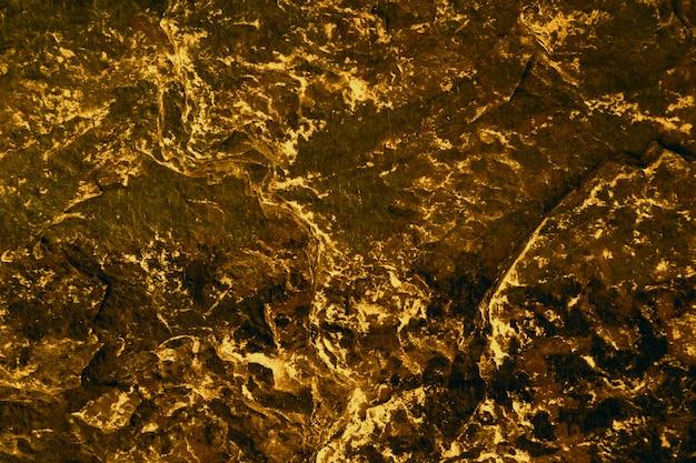 内部の洞窟の古代硫黄花崗岩の石の表面