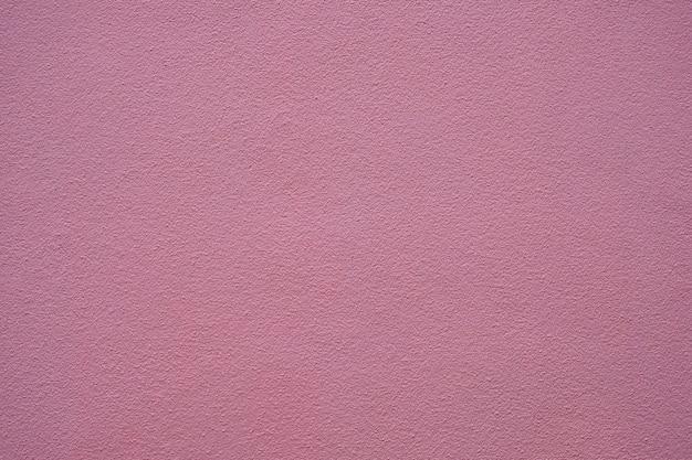 ピンク色の壁の背景のアート。