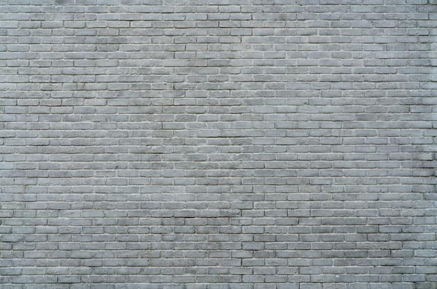 テキスト用のスペースと白と灰色のレンガの壁のテクスチャ背景。