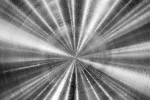 詳細と反射する背景の光沢がある空のステンレス鋼板