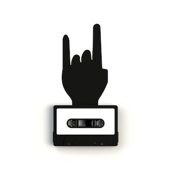 白い背景の上のロック手サイン概念図とビンテージオーディオテープカセットのクローズアップ