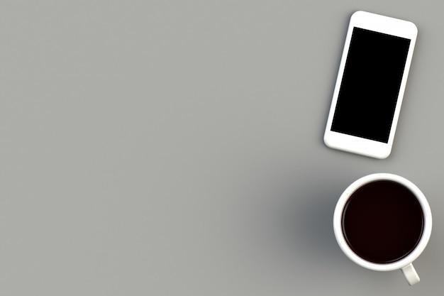 灰色の背景上のスマートフォンとコーヒーカップ