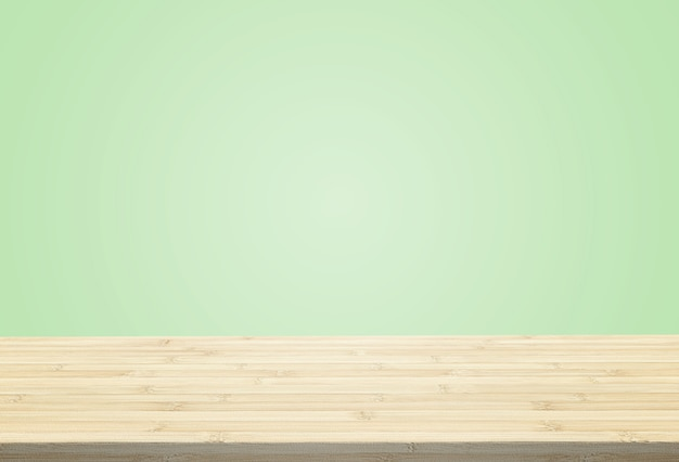 パステルグリーンの背景の上にテーブルトップをラミネートすることができますまたはあなたの製品をモンタージュ